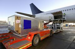 Loading cargo onto aircraft Stock Photos