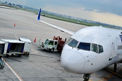 Loading cargo on a plane stock images