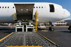 Loading cargo plane. Loading platform of air freight to the aircraft Royalty Free Stock Photography