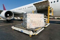 Loading cargo plane. Loading platform of air freight to the aircraft Royalty Free Stock Photo