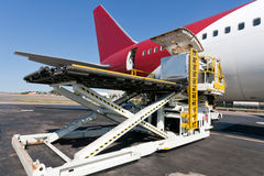 Loading cargo plane Royalty Free Stock Images