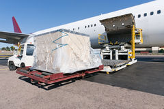 Loading cargo plane Stock Images