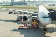 Loading cargo on plane in airport before flight. Stock Photo