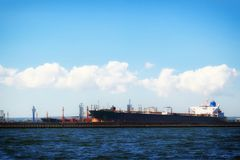Loading cargo ship in port Gdansk, Poland. Royalty Free Stock Images