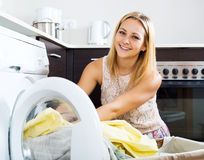 Loading clothes into washing machine Royalty Free Stock Photography