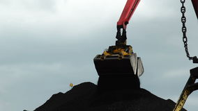 Loading of Coal. Ladle Crane Loading Coal in the Port