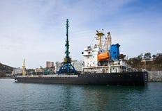 Loading of coal in the port of Nakhodka. Nakhodka Bay. East (Japan) Sea. 20.10.2012 Royalty Free Stock Images