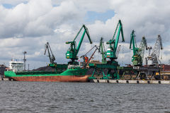 Loading of coal on ship in port of Gdynia Stock Photos