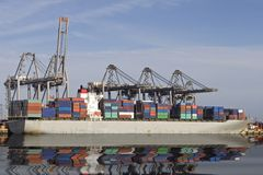 Loading container ship. A ship at Southampton docks, being loaded with containers Royalty Free Stock Image