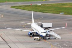 Loading containers in the cargo aircraft Stock Photos