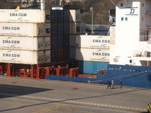 LOADING CONTAINERS ON HARBOUR Stock Photo