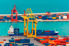 Loading containers on a sea cargo ship, Barcelona Stock Photography