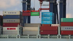 Loading containers on a ship stock video footage