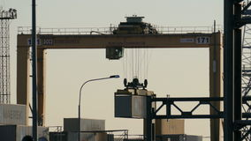 Loading crane with cab lifts up the container
