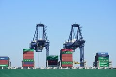 Loading Cranes with Containers on boat Stock Image