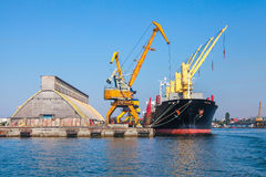 Loading with cranes of Industrial cargo ship Stock Photography