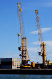 Loading cranes by the sea Royalty Free Stock Photography