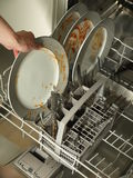 Loading dishwasher Royalty Free Stock Images