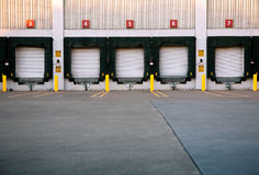 Loading Dock. Five doors at a commercial loading dock Stock Photography