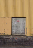 Loading Dock Number 4 yellow wall stock photos