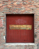 Loading dock in an old building. Loading door or dock in an old industrial building with a Do not block sign on the door Royalty Free Stock Photos