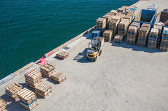 Loading Dock. In the port with forklift and pallets Royalty Free Stock Photography