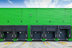 Loading docks in industrial warehouse Stock Photos