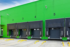 Loading docks in industrial warehouse Stock Image