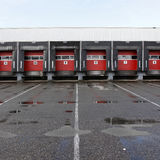 Loading docks with red doors on rainy day sq Royalty Free Stock Images