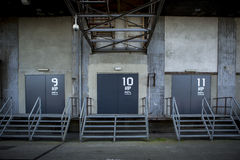 Loading doors in abandoned  factory Stock Images