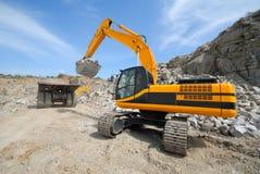 Loading by dredge. Loading by  dredge, in granite to career Stock Photo