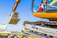 Loading excavator on semi trailer Royalty Free Stock Photo