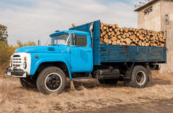 Loading of felled timber in a truck with crane Royalty Free Stock Images