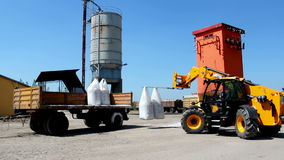 Loading fertilizer application. Loading fertilizer with special forklifts,video clip stock footage