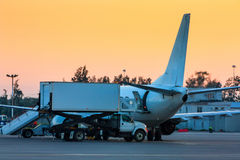 Loading food on a plane. In the early morning royalty free stock photography