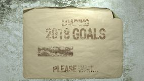 Loading 2018 goals. Old paper ad on a cement wall with a progress bar inscription loading 2018 goals please wait. imitation of camera shake and light flashes royalty free illustration