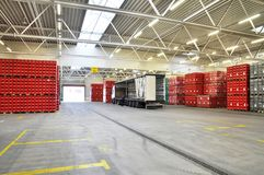 Loading of goods in a brewery warehouse - beer crates with beer. Bottles stock images
