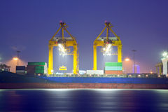 Loading Goods Container to ship Stock Photos