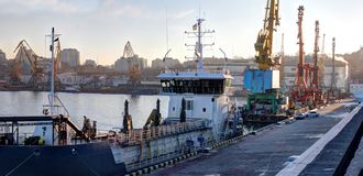 Loading grain in the port. Evening panoramic view of the port stock images