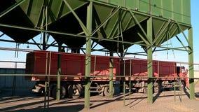 Loading grain into storage stock video