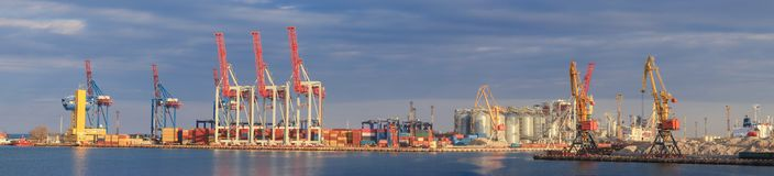 Loading grain to the ship in the port. Panoramic view stock image