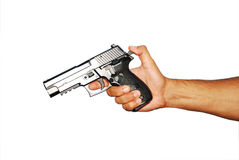 Loading gun. Hand load a gun on a white isolated background Stock Photography
