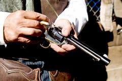 Loading a Gun. Upclose horizontial photo loading bullets into a handgun Royalty Free Stock Images