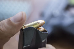 Loading Handgun Magazine. Bullets and Pistol Background. Charging Gun. Stock Photos