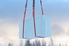 Loading ice block with a crane. Ice block, close-up royalty free stock photo