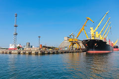 Loading of Industrial cargo ship Stock Images