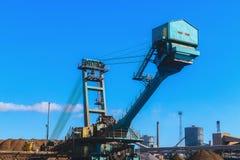 Loading iron ore conveyor machine in steel industry Stock Photos