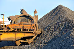 Loading iron ore conveyor machine Stock Image