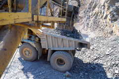 Loading of iron ore Kind from a cabin Stock Photos