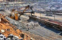 Loading of iron ore on the train. In career royalty free stock photo
